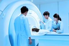 veterinarian doctor working in MRI scanner room  Royalty Free Stock Image