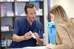 Veterinarian giving instructions to client Royalty Free Stock Photo