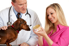Veterinarian: Holding a Can of Dog Food Stock Photography