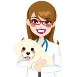 Veterinarian Hugging Puppy Royalty Free Stock Photo