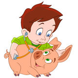 Veterinarian and pig. Cute young veterinarian boy is treating a pig Royalty Free Stock Photography