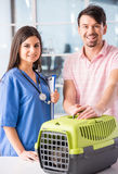 Veterinarian. Young men carrying a cat in a box to a veterinarian Stock Images