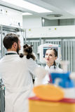 Veterinarians in Intensive Care Unit of pet clinic with cat. Discussing Stock Photography