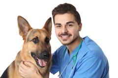 Veterinario doc. con el perro en blanco fotos de archivo libres de regalías
