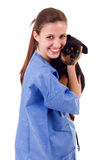 Veterinary. Brunette veterinary with a rottweiler puppy dog isolated on white background Stock Photos