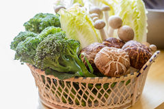 Vetgetable in basket. Cabbage, broccoli, mushrooms in the basket Stock Photo