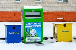 Multicolored containers for separate collection of garbage on city street Stock Images