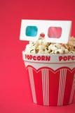 vetri 3D & una benna di popcorn Fotografie Stock