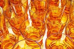 Vetri arancio d'annata dell'alcool Fotografie Stock