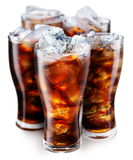 Vetri con i cubi di ghiaccio e della cola Fotografia Stock Libera da Diritti