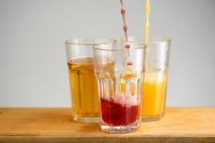 Vetri con il succo di mela, dell'arancia e della ciliegia Fotografia Stock