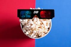 vetri 3d sul contenitore di popcorn Immagine Stock