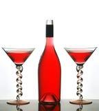 Vetri del Martini e vino rosso Fotografia Stock