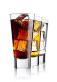 Vetri della cola e dell'acqua frizzante della bevanda di energia Immagini Stock