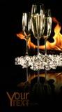 Vetri di champagne con ghiaccio e fuoco Fotografia Stock