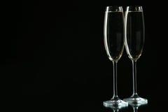 Vetri di champagne sul nero Fotografia Stock Libera da Diritti