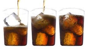 Vetri di cola con ghiaccio Immagini Stock