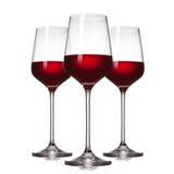 3 vetri di vino rosso su bianco Fotografie Stock