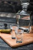Vetri di vodka sulla tavola di legno Fotografia Stock