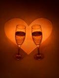 Vetri e cuore di Champagne Immagine Stock