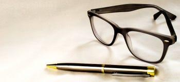 Vetri e penna Fotografie Stock