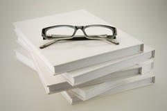 Vetri sui libri bianchi Fotografia Stock