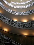Vetrical view of Vatican spiral stears. Tourist descending on the spiral stairs in Vatican museum Royalty Free Stock Photo