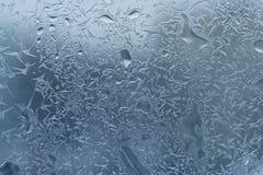 Vetro con gelo e gocce Fotografia Stock