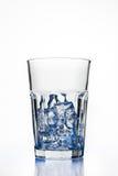 Vetro con i cubi di ghiaccio Fotografia Stock