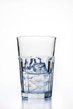 Vetro con i cubi di ghiaccio Fotografie Stock