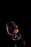 Vetro con l'alcool del cognac Fotografia Stock