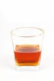 Vetro del brandy dell'elite su un fondo bianco Immagine Stock Libera da Diritti