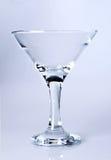 Vetro del Martini su rosso-chiaro Fotografie Stock