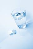 Vetro dell'aspirina Fotografia Stock