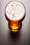 Birra chiara sulla tavola Immagine Stock Libera da Diritti