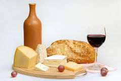 Vetro della bottiglia e del formaggio di vino Fotografie Stock