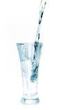 Vetro di acqua su bianco Fotografia Stock Libera da Diritti