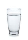 Vetro di acqua su priorità bassa bianca Fotografia Stock Libera da Diritti