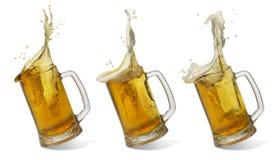 Vetro di caduta di birra Fotografia Stock