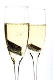 Vetro di champagne con la parte di cioccolato all'interno Immagine Stock Libera da Diritti