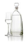 vetro di grappa con una bottiglia Immagini Stock Libere da Diritti