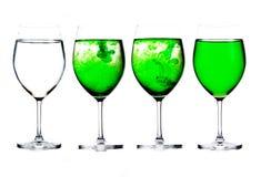 Vetro di limonata verde isolato su fondo bianco Fotografia Stock