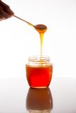 Vetro di miele fresco Fotografie Stock