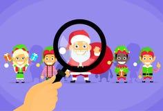 Vetro di Santa Clause Christmas Elf Magnifying Immagine Stock Libera da Diritti