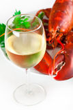 Vetro di vino bianco con l'aragosta Immagine Stock