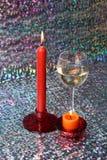 Vetro di vino e delle candele Fotografia Stock