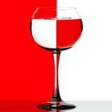 Vetro di vino su rosso e su bianco Fotografia Stock Libera da Diritti