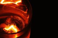 Vetro di whiskey & del cubetto di ghiaccio, festa Fotografia Stock