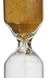Vetro dorato della sabbia isolato su bianco fotografia stock