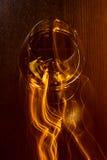 Vetro dorato di whiskey e delle linee gialle Immagine Stock Libera da Diritti